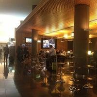 Photo taken at Qantas Club (T3) by Nick B. on 5/7/2013