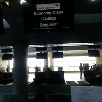 Photo taken at Garuda Indonesia Check In Counter by A H. on 12/14/2013