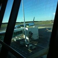 Photo taken at Gate G8 by Ken on 12/9/2012