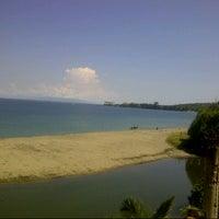 Photo taken at Pantai Senggigi by Nadia S. on 5/16/2013