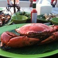 Photo taken at Kampung seafood Jimbaran by Alexey S. on 4/2/2013