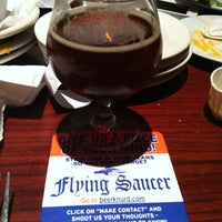 Photo taken at Flying Saucer by Sarah H. on 12/17/2012