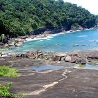 Photo taken at Praia das Conchas by Marcos S. on 1/18/2014