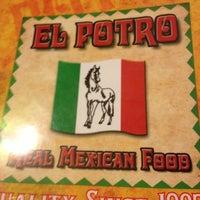Photo taken at El Potro by Erica M. on 11/19/2012