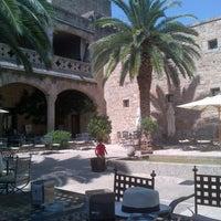 Photo taken at Hotel Parador de Jarandilla de la Vera by Carlos B. on 7/13/2013