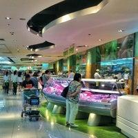 Photo taken at The Landmark Supermarket by Edgar K. on 9/28/2012