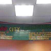 Photo taken at Soap City Laundromat by champ l. on 9/2/2013