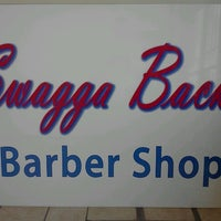 Photo taken at Swagga Back Barber Shop by Cedric B. on 12/24/2012