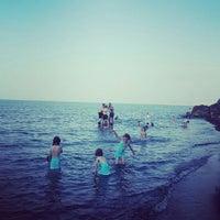 Photo taken at Akçakale plajı by Nazlı E. on 7/28/2015