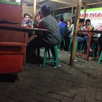 Photo taken at Warung Lamongan Seafood by Achmad R. on 6/1/2014