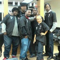 Photo taken at Ebony Barbers by Erin S. on 10/12/2012