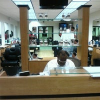 Photo taken at Ebony Barbers by Erin S. on 9/29/2012