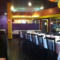 Photo taken at Mojitos Cuban Bar & Restaurant by Cesar R. on 3/10/2013