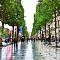 Photo taken at Avenue des Champs-Élysées by Louie C. on 5/18/2013