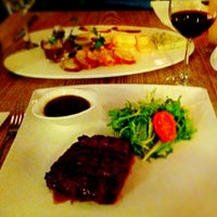 Photo taken at Flamme The Ultimate Steak by Dmitry K. on 3/9/2013