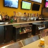 Photo taken at Buffalo Wild Wings Grill & Bar by Adam J. on 4/15/2017