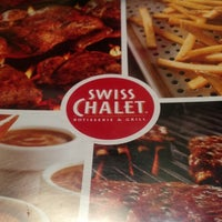 Photo taken at Swiss Chalet by Tina W. on 10/13/2012