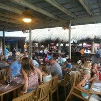 Photo taken at Sharky's Beachfront Restaurant by Emre Ç. on 7/24/2015