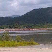 Photo taken at Playa de Boca de Uchire by Norman H. on 6/8/2013