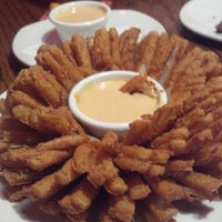 Photo taken at Outback Steakhouse by Julia M. on 12/31/2012
