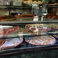 Photo taken at Knapp St Pizza by Renato M. on 7/2/2013