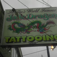 Photo taken at Jade Dragon Tattoo and Exotic Body Piercing Studio by Carl W. on 2/28/2013