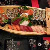 Photo taken at Ocean Sushi by Jan M. on 12/21/2012