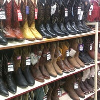 Photo taken at Justin Boots by Robert P. on 11/9/2012