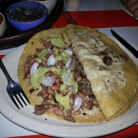 Photo taken at Tacos Ta' Kaliente by Shaggy R. on 2/1/2014