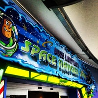 Photo taken at Buzz Lightyear's Space Ranger Spin by Dan N. on 1/3/2013