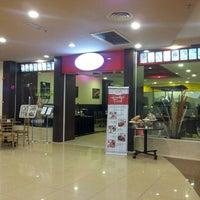 Photo taken at The Raintree Café by Ahmad Kamal E. on 4/19/2014
