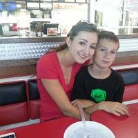 Photo taken at Carl's Jr. / Green Burrito by Chuck H. on 8/27/2013