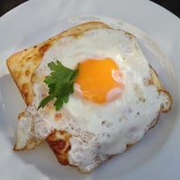 Photo taken at Le Petit Café by Roman K. on 9/15/2012
