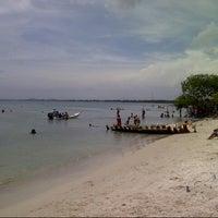 Photo taken at Playa El Oasis by Rodolfo M. on 9/23/2012
