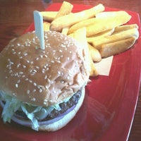 Photo taken at Red Robin Gourmet Burgers by Chris A. on 8/16/2013