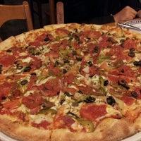 Photo taken at Brick Oven New York Pizzeria by Aryan J. on 10/26/2013
