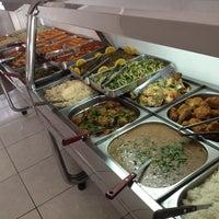 Photo taken at Puro Sabor Restaurante by Carol S. on 8/11/2013