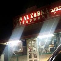 Photo taken at Al Zarka Restaurant by Sàqib S. on 10/23/2014