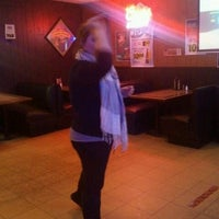Photo taken at Bottoms Up Bar & Grill by Aramis P. on 2/18/2013