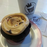 Photo taken at Cupcake Royale and Vérité Coffee by Ashlee M. on 5/2/2013