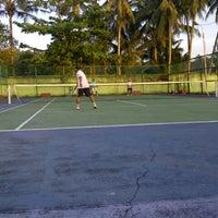 Photo taken at Lapangan Tenis P & K Plus by Yudo A. on 2/2/2013