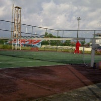 Photo taken at Lapangan Tenis P & K Plus by Yudo A. on 7/26/2015