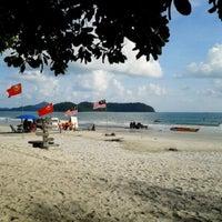 Photo taken at Pantai Cenang (Beach) by Ridhuan O. on 5/23/2013