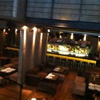 Photo taken at BASA - Basement Bar & Restaurant by Ariel E. on 7/18/2013