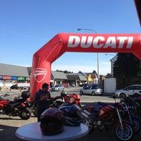Photo taken at Ducati Store by Emmanuelle J. on 4/20/2013