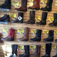 Photo taken at Stompers Boots by poetic d. on 11/10/2012
