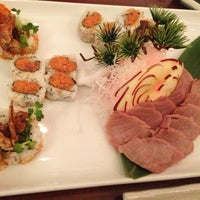 Photo taken at Midori Sushi by Tiffany L. on 12/25/2012