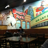 Photo taken at Beggars Pizza by Jeannette V. on 2/15/2013