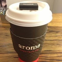 Photo taken at Aroma Espresso Bar by Clark C. on 2/9/2013