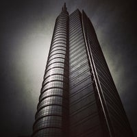 Photo taken at Unicredit Tower by Fabio on 5/20/2013